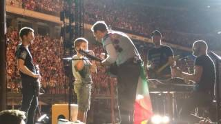 Coldplay and a 9-year-old boy perform Don't Panic (with harmonica)