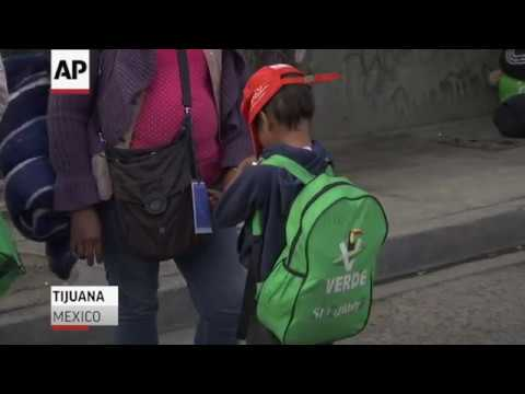 More buses of exhausted people in a caravan of Central American migrants reached the U.S. border Thursday. Migrants crowded Tijuana streets and looked on as officials fortified the border with razor wire and heavily armed agents stood guard. (Nov. 16)