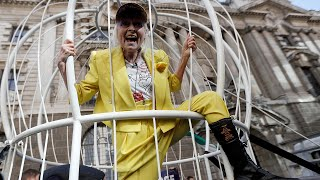 video: Dame Vivienne Westwood suspends herself in cage in support of Julian Assange