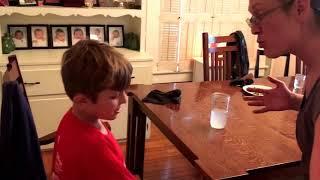 angry mom makes kid eat salad out of trash