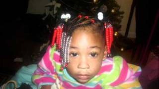 Natural kids hairstyle: Beads, braids, and ponytails
