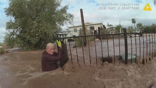 RAW: Body cam captures rescue of elderly man found clinging to fence in Apache Junction floodwaters