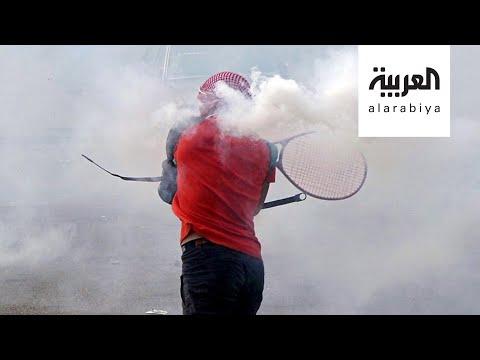 العرب اليوم - شاهد: لبنانيون يتصدّون لقنابل الغاز بـ