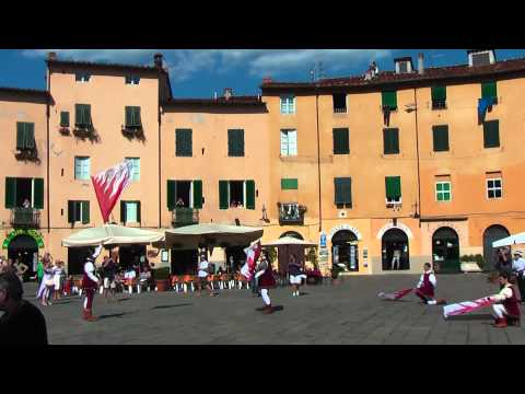 Drummers and flag wavers (procession of Santa Croce) on Piaza Anfiteatro in Lucca (Tuscany Italy)
