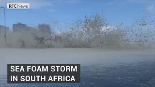 Heavy downpours and gale-force winds hit the South African city of Cape Town today, triggering severe weather warnings.  According to local media, strong winds downed several trees in residential areas and roofs were torn off after a powerful storm made landfall last night.  Videos showed huge waves on the coastline sending sea foam flying on to the road.  The storm also brought snow and a cold front, accompanied by gale-force winds of up to 100km/h.  Read: https://bit.ly/3fq6nbf  Keep up to date with all the latest Irish and international news and current affairs with http://www.rte.ie/news  Follow us on twitter @rtenews and on Facebook http://www.facebook.com/rtenews