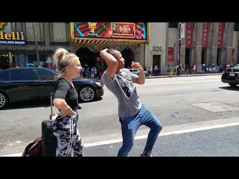 Fik-Shun & girlfriend Cassidy Payne dancing on Hollywood Blvd