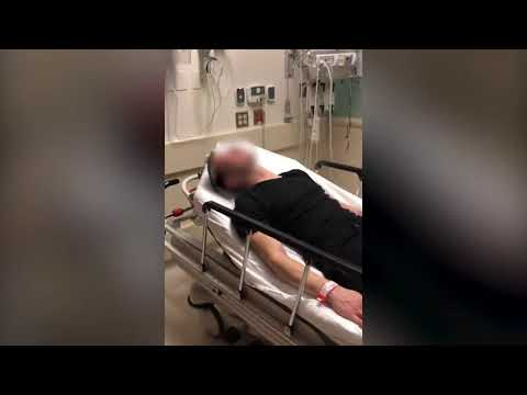 Cop strikes an attempted suicide victim in the hospital