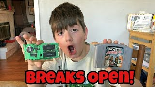 Kid Temper Tantrum Breaks Open A Nintendo 64 Game To See What's Inside It.