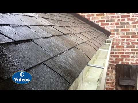 Working gutters during a rain shower