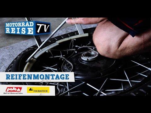Motorradreifen von Hand montieren