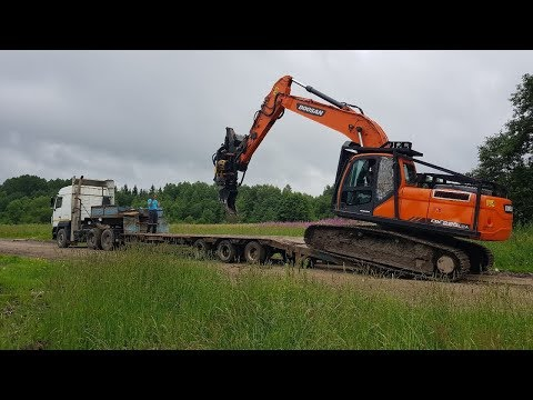 Перевозка техники на трале за тягачом МАЗ. Doosan, ЧТЗ, Ponsse.