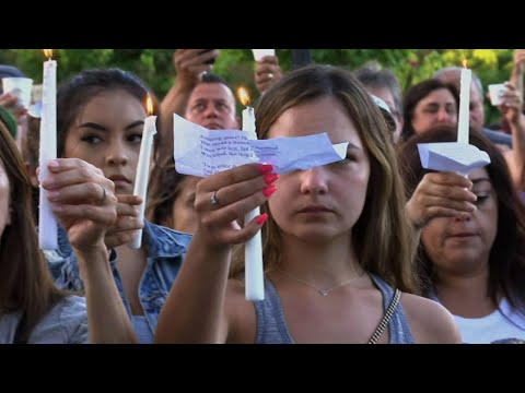 Hundreds of Gilroy, California residents came to City Hall to light candles, comfort each other and show strength after Sunday night's shooting that killed three people, including two children, ages 6 and 13. (July 30)