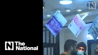 Iraq's central bank devalues dinar by 23%