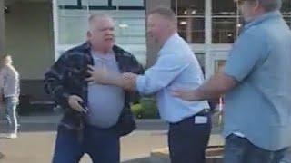 Watch: Fred Meyer worker shoves man during parking lot spat