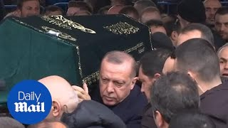 President Erdogan carries coffin of victim of apartment collapse