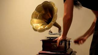Playing the His Master's Voice hand crank gramophone.