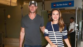Justin Hartley And Fiancee Chrishell Stause Arm In Arm At LAX