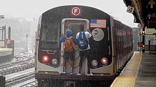 Train surfers on back of R160 F train at Ditmas Avenue (Rain)