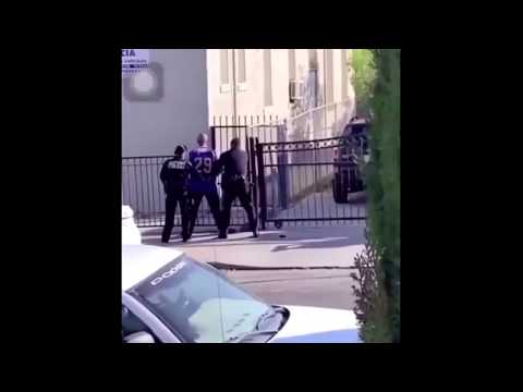 Easily Offended Police Officers Beat Man In Handcuffs