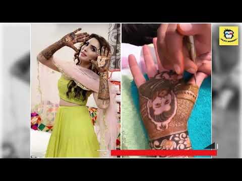 Mansi Sharma gets beau Yuvraj Hans' face drawn with henna on her hand during mehendi