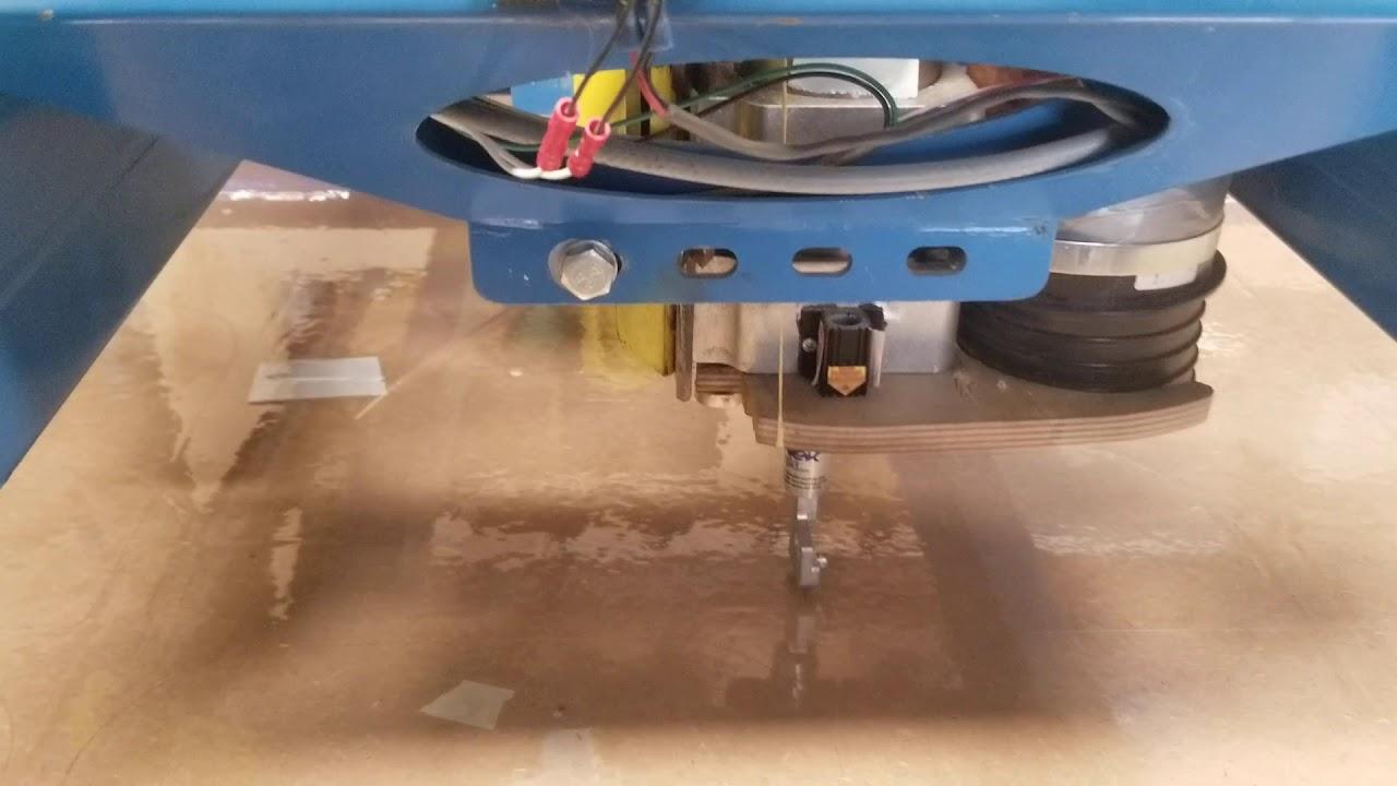 My custom kayak paddle making CNC machine cutting the shields