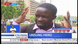 Victor Muyakane a journalist carries a person with disabilities helping him escape a swarm of bees