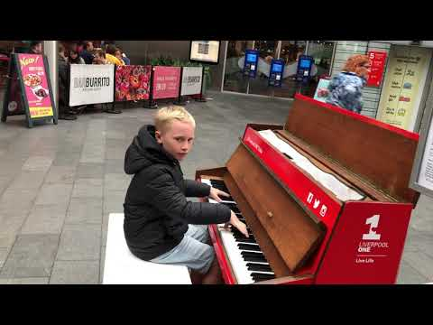 Kids plays top dance tracks on a public piano