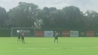 Carson Wentz throws on the run during 1st practice at Eagles training camp