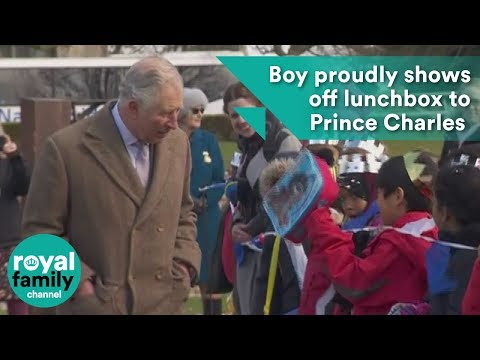 Boy proudly shows off lunchbox to Prince Charles at Tattershall Castle