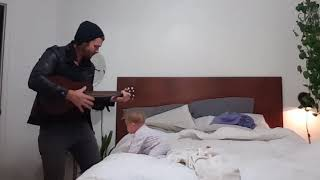 Dad sings to daughter with ukulele