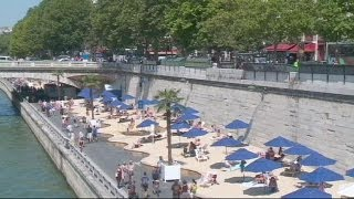 Parisians flock to city 'beaches' to enjoy summer sunshine