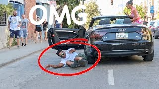 GUY FALLS OUT OF CAR TRYING TO IMPRESS GIRL!!!