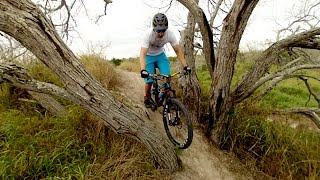 Derrick Perrin rides the Corpus Christi trails with Mike Cartier.