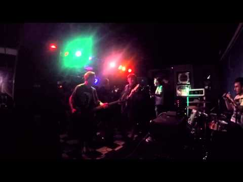 This is a live performance of my old band Tenants. I played drums and sang.