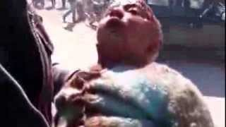 preview picture of video 'درعا | المزيريب :: صور لـ مجزرة مروعة نتيجة استهداف البلدة بالبراميل المتفجرة 18-2-2014'