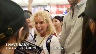 I Have A Baby Woman Screams At Hong Kong Airport Plus Woman in Red making her way Through