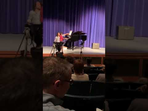 My student, Saif, playing at the student recital in 2019. He has been my student since he began playing piano 2 months ago.