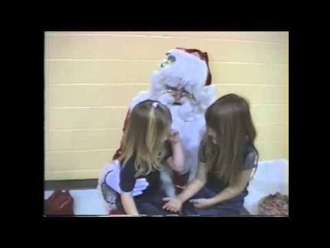 Santa makes little girls kiss!