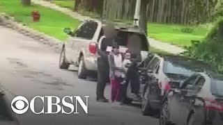 Video shows Chicago mom shot while holding child