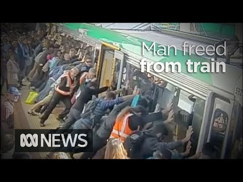 People power frees man trapped by Perth train | ABC News