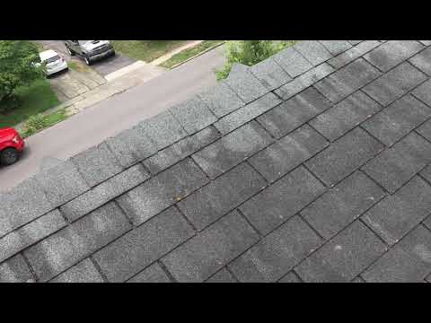 Inspecting a steep roof in the Lexington area. Definite signs of wind damage on this roof.