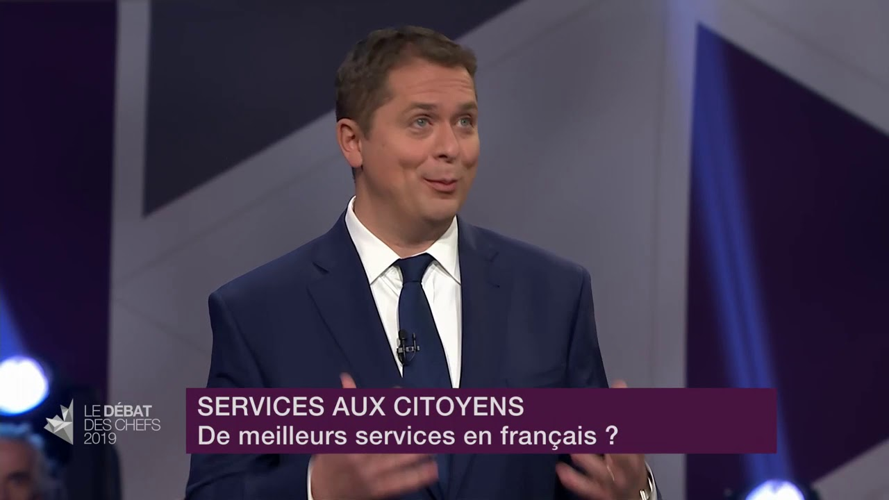 Andrew Scheer answers a question about services in French