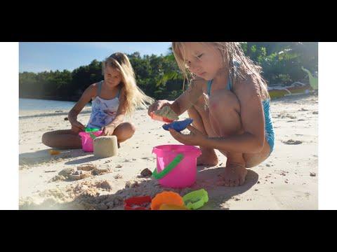 Сhildren play in the sandbox on the beach 4K