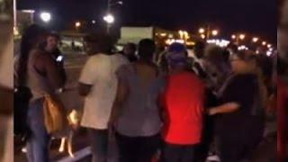 Raw: Gunshots After Car Hits Ferguson Protester