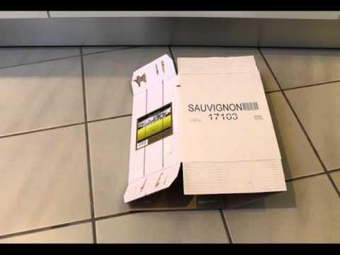 Make A Fancy Wine Bottle Display With A Cardboard Box