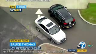 RAW VIDEO: Robbery suspects dodge pit maneuver, flee moving vehicle during LA chase   ABC7