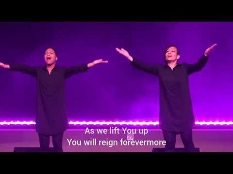 "Signing ""Yours"" by Elevation Worship at church."