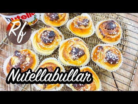 Nutellabullar eller Nutellasnäckor. Som kanelbullar men utan kanel och istället toppade med Nutella - hasselnötscrème. Här rullade och skurna som snäckor men de kan också bakas som snurror.>