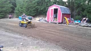 Mini dozer pushing dirt - Most Popular Videos