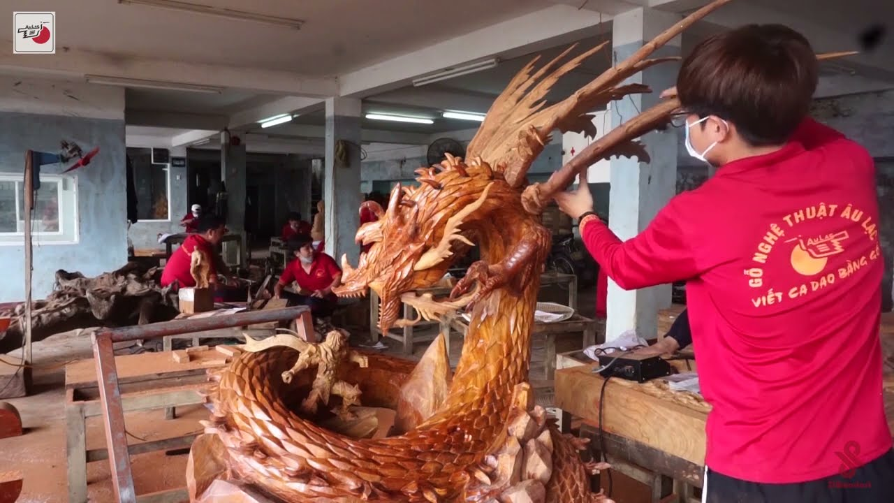 amazing huge wood carving lord warrior fighting dragon